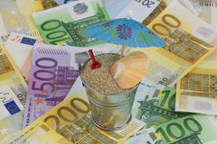 Holiday fund. Bucket with sand on banknotes Royalty Free Stock Photos