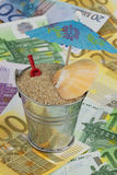 Holiday fund 2. Bucket with sand on banknotes Royalty Free Stock Images