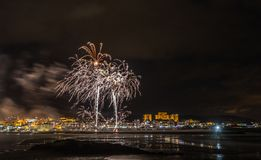 Holiday in the Galician coast. Where at night celebrating the festivities in the town of Foz, spain, we contemplate the fireworks worthy of admiration Stock Photos