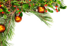 Holiday garland. With ornaments, pine branches, pine cones and evergreen with berries (Common Bearberry/Kinnikinnick Royalty Free Stock Photo