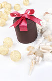 Holiday gift. With red riband and various seashells on the white background Stock Image
