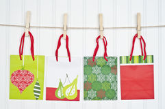 Holiday Gift Bags on a Clothesline Stock Photography