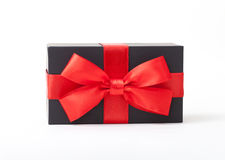Holiday gift. Black box with a red bow. Royalty Free Stock Photography