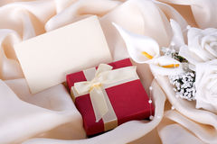 Holiday gift with a bouquet Stock Photo