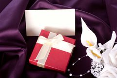 Holiday gift with a bouquet and postcard Royalty Free Stock Photos