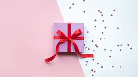Valentine`s Day. Christmas pink gift box. Christmas present. With copy space. royalty free stock image