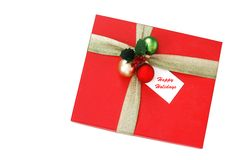 Holiday gift box. With happy holidays tag Stock Images