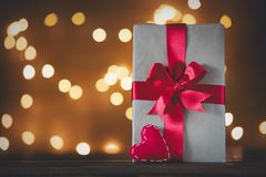 Holiday gift box and heart hape toy on Fairy Lights Stock Images