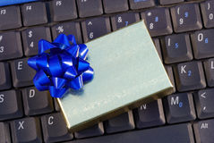 Holiday gift box on a keyboard Royalty Free Stock Photos