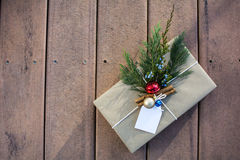 Holiday gift box outside on the deck and sunset shadow. Brown paper holiday gift box outside on the deck and sunset shadow Royalty Free Stock Photos
