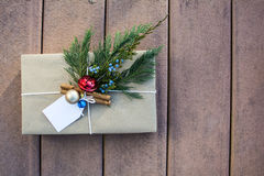 Holiday gift box outside on the deck and sunset shadow. Brown paper holiday gift box outside on the deck and sunset shadow Royalty Free Stock Photography