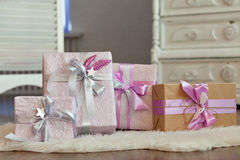 Holiday gift boxes decorated with ribbon. Beautiful purple shiny package for Christmas and New Year. Sebebryannaya tape Stock Photo