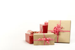 Holiday gift boxes decorated with ribbon isolated on white background. Royalty Free Stock Image