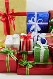 Holiday gift boxes decorated with ribbon  on white. Background Stock Photos