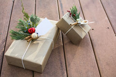 Holiday gift boxes outside on the deck and sunset shadow. Brown paper holiday gift boxes outside on the deck and sunset shadow Royalty Free Stock Photography