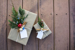 Holiday gift boxes outside on the deck and sunset shadow. Brown paper holiday gift boxes outside on the deck and sunset shadow Royalty Free Stock Images