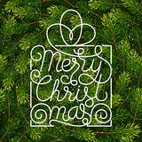 Holiday gift card with hand lettering Merry Christmas on Christmas fir tree branches background Royalty Free Stock Image