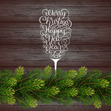 Holiday gift card with hand lettering Merry Christmas and Happy New Year in the form of a glass of champagne and Stock Photography
