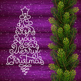 Holiday gift card with hand lettering We Wish You a Merry Christmas in the form of a Christmas tree on wood background Stock Images