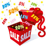 Holiday gift packaging box with bow from which the fireworks fly colorful symbols per cent for sales and great deals Stock Images