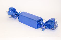 Holiday gift packed as a big candy. Gift packed in blue holiday wrapping as a big candy Royalty Free Stock Photo