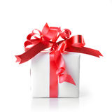 Holiday gift with red ribbon isolated Royalty Free Stock Photo