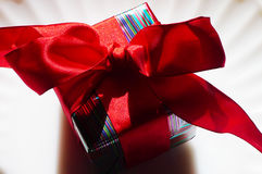 Valentine Gift-shadow. Holiday gift giving, wrapped gift box on white Royalty Free Stock Image