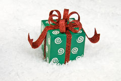Holiday gift in snow Royalty Free Stock Photo