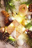 Holiday gift under Christmas tree wrapped with twine and wrappin Stock Photography