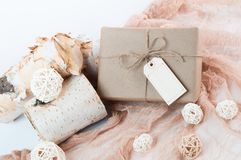 Holiday gift wrapped in brown paper Royalty Free Stock Photos