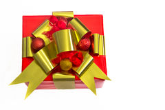 Holiday Gift Wrapped in Red with Gold Ribbons Stock Image
