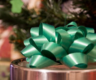 Holiday gifts. A green ribbon on a holiday gift Stock Image
