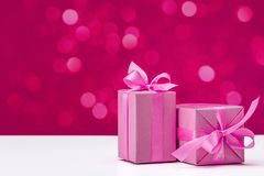 Free Holiday Gifts In Pink Boxes With Ribbons. Stock Photography - 130658502