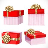 Holiday gifts in red boxes with gold bow Stock Images