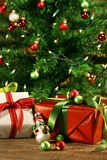 Holiday gifts under a tree Stock Photo