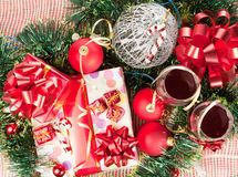 Holiday gifts and wine glasses Stock Images