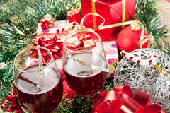 Holiday gifts and wine glasses Royalty Free Stock Photo
