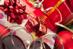 Holiday gifts and wine glasses Royalty Free Stock Image