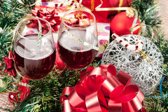 Holiday gifts and wine glasses Royalty Free Stock Images