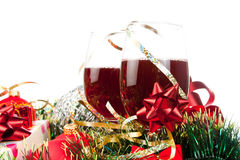 Holiday gifts and wine glasses Stock Photos