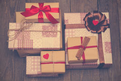 Holiday gifts on wooden background in vintage style Royalty Free Stock Image