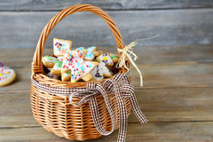 Holiday ginger cookies in a wicker basket on boards Royalty Free Stock Photography