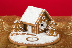 Holiday Gingerbread house on red. Stock Photo