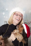 Holiday girl and dog Royalty Free Stock Photo