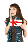 Holiday girl holds a white envelope and dreams Stock Image
