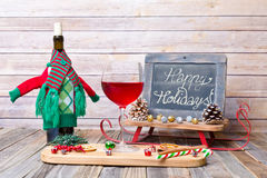 Holiday glass of red wine with chalkboard sign Stock Images