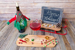 Holiday glass of red wine with chalkboard sign Royalty Free Stock Photography