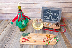 Holiday glass of white wine with chalkboard sign Stock Photography