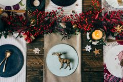 Holiday Gold place setting, funny Christmas table with ornaments Stock Photography