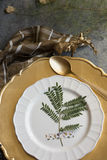 Holiday Gold place setting, napkin brown plaid, on grunge backgr Royalty Free Stock Photography